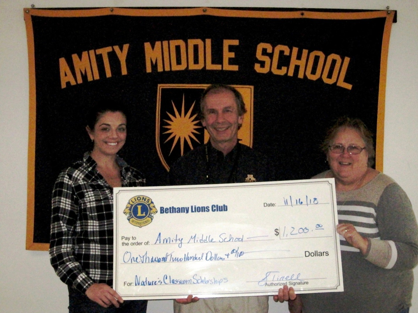 BETHANY LIONS CLUB PRESENTS $1,200 CHECK TO AMITY MIDDLE SCHOOL IN BETHANY AS A SCHOLARSHIP FUND FOR NATURE'S CLASSROOM